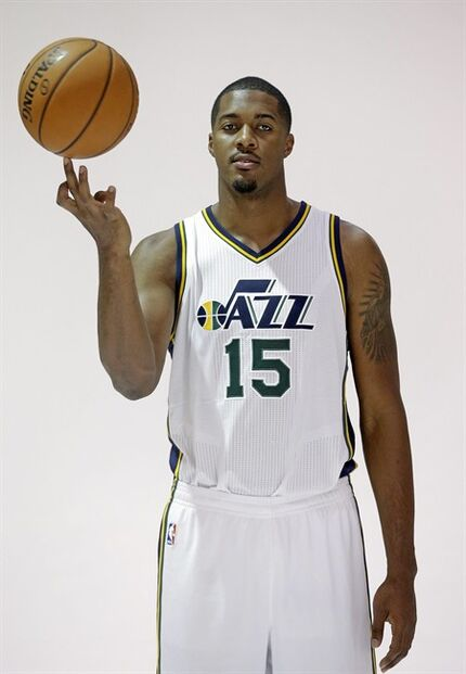 Utah Jazz's Derrick Favors poses for a photo during the NBA basketball media day Monday, Sept. 29, 2014, in Salt Lake City. (AP Photo/Rick Bowmer)