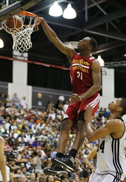 Andrew Wiggins of the Cleveland Cavaliers dunks against the Milwaukee Bucks in an NBA summer league basketball Friday, July 11, 2014, in Las Vegas. (AP Photo/John Locher)
