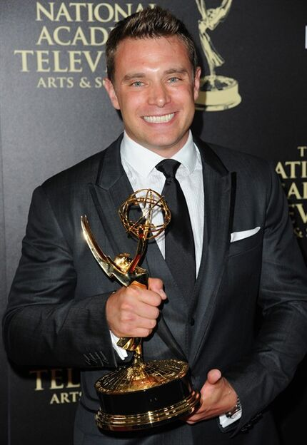 "FILE - In this June 22, 2014 file photo, actor Billy Miller poses in the press room with the award for outstanding lead actor in a drama series for ""The Young and the Restless"" at the 41st annual Daytime Emmy Awards in Beverly Hills, Calif. Miller is now playing Jason Morgan on ABC's"