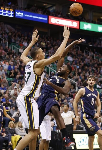New Orleans Pelicans forward Tyreke Evans (1) is defended on a shot by Utah Jazz center Rudy Gobert (27) during the first half of their NBA Basketball game in Salt Lake City, Utah, Saturday, Nov. 22, 2014. (AP Photo/Jim Urquhart)