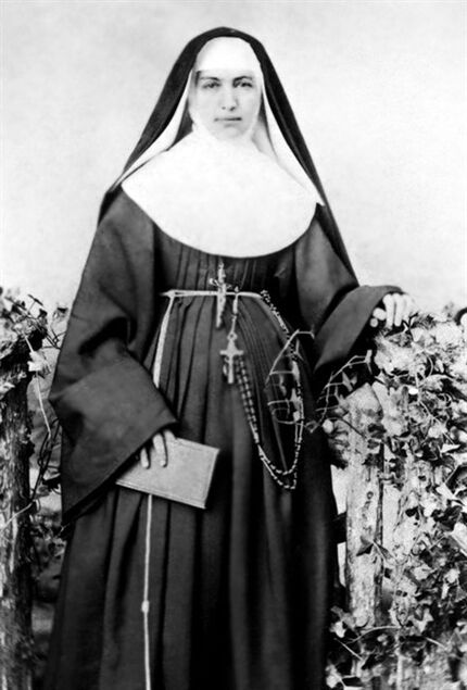 FILE - In this 1883 file photo provided by the Sisters of St. Francis of the Neumann Communities, Mother Marianne Cope, a nun who dedicated her life to caring for exiled leprosy patients on Kalaupapa in Hawaii, poses for a photographer. St. Marianne Cope's remains will arrive in a hearse Thursday, July 31, 2014, at Cathedral of Our Lady of Peace in downtown Honolulu for a ceremony. The remains will be kept in a cabinet in the cathedral. (AP Photo/Sisters of St. Francis of the Neumann Communities, File)
