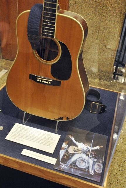 FILE - This April 22, 2013 file photo shows the slightly smashed acoustic guitar played by Elvis Presley during the final tour before his death in 1977 on display at the National Music Museum in Vermillion, S.D. The guitar may have to taken off display. A lawsuit filed in July 2014 in South Dakota is seeking to determine who is the legal owner of�the guitar. Memphis-based guitarist Robert Johnson donated the Elvis guitar last year to the museum, but a man now claims he is the owner of the slightly smashed acoustic guitar. (AP Photo/Dirk Lammers, File)