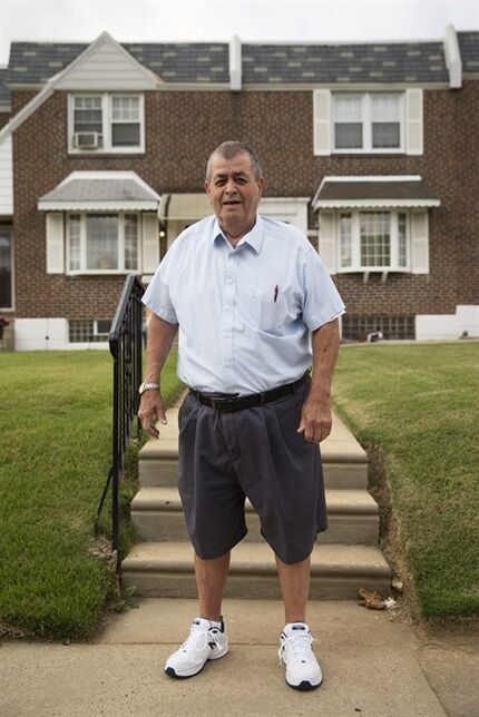 In this Thursday, Sept. 11, 2014 photo, Myles Griffin, 74, poses for a photograph in front of his home in Philadelphia. Griffin has lived with his wife for 40 years in their three-bedroom row home and after retiring three years ago, the couple signed up for a reverse mortgage in May. (AP Photo/Matt Rourke)