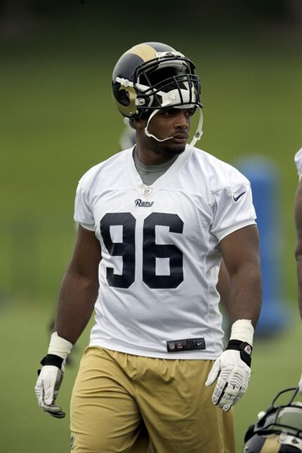 FILE - In this Junr 5, 2014 file photo, St. Louis Rams defensive end Michael Sam (96) takes part in an organized team activity at the NFL football team's practice facility in St. Louis. Coach Jeff Fisher and general manager Les Snead deserve kudos for making the Rams the first NFL team to draft an openly gay player. And for not making it a big deal. (AP Photo/Jeff Roberson, File)