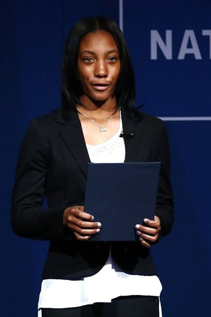 Little League pitcher Mo'ne Davis reads a selection of Malala Yousafzai's blog who is this years recipient of the Liberty Medal during a ceremony at the National Constitution Center, Tuesday, Oct. 21, 2014, in Philadelphia. The honor is given annually to an individual who displays courage and conviction while striving to secure liberty for people worldwide. (AP Photo/Matt Rourke)