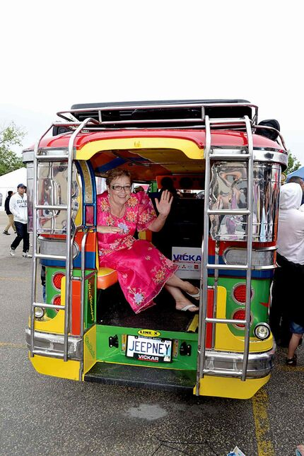 Melanie Wight, MLA for Burrows, gets a ride on a traditional Filipino Jeepney at last year's Filipino Street Festival.