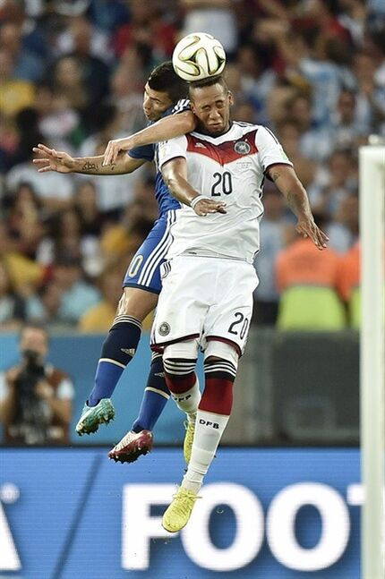 FILE - In this July 13, 2014 file photo, Argentina's Sergio Aguero, left, contests a high ball with Germany's Jerome Boateng (20) during the World Cup final soccer match between Germany and Argentina at the Maracana Stadium in Rio de Janeiro, Brazil. The World Cup tournament placed second on Google's list of 2014's fastest-rising global search requests, the company said Tuesday, Dec. 16, 2014. (AP Photo/Martin Meissner)