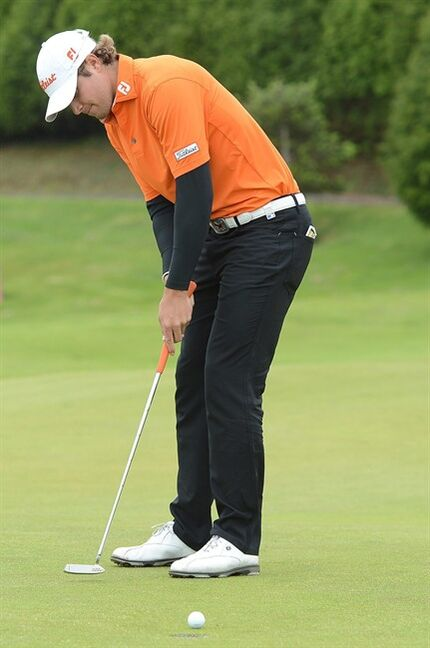 Peter Uihlein, of the US, putts on the 18th hole during the last round of the Madeira Islands Open Sunday, May 19 2013, at the Santo da Serra golf course, in Machico, Portugal. Uihlein shot a 15-under-par total of 273 to win the tournament. (AP Photo/Helder Santos)