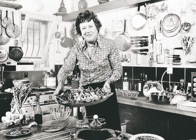 Julia Child showing a salade nicoise she prepared in the kitchen of her vacation home in Grasse, southern France.