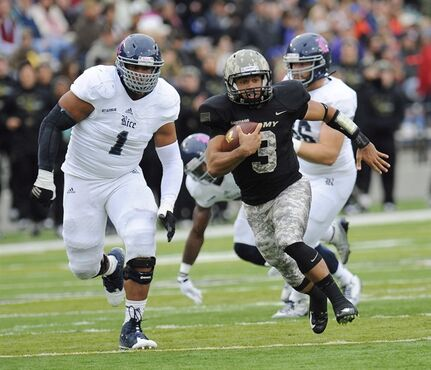 Rice defensive tackle Christian Covington (1) chases Army quarterback Angel Santiago (3) during the first half of an NCAA college football game in West Point, N.Y., on Oct. 11, 2014. Christian Covington doesn't have to go far to begin his pro football career. The Rice defensive lineman went in the sixth round, No. 216 overall, to the Houston Texans in the NFL draft Saturday. The school is roughly five kilometres from NRG Stadium, the club's home venue. THE CANADIAN PRESS/AP, Hans Pennink