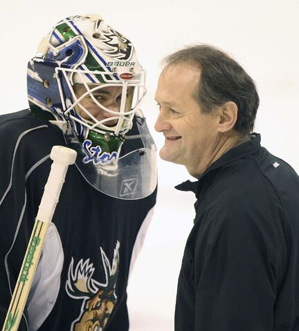 Manitoba Moose goaltender Eddie Lack, left, shares a laugh with coach Rick St. Croix during a break in practice in 2011. (Joe Bryksa / Free Press files)