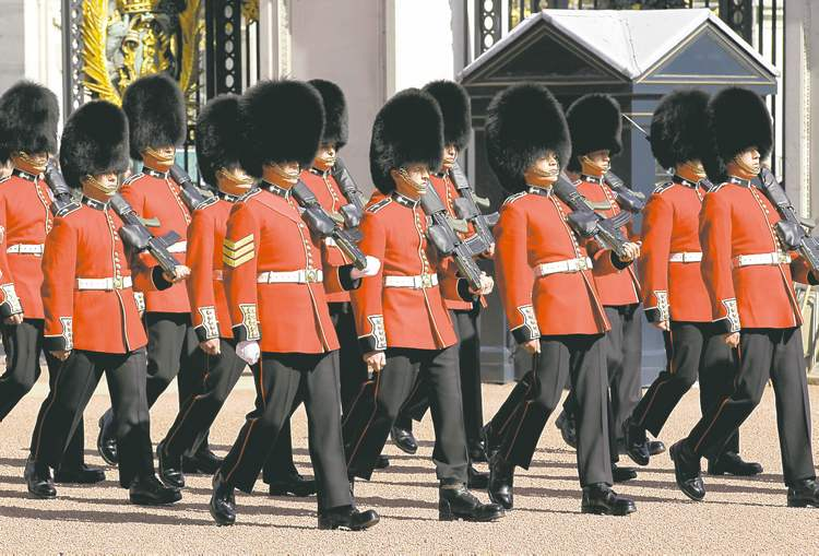 Welsh Guards perform their changing of guard ceremony at Buckingham Palace.