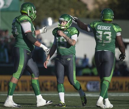 Saskatchewan Roughriders kicker Chris Milo, centre, is congratulated for kicking a field goal against the Ottawa Redblacks during overtime CFL football action at Mosaic Stadium on Sunday, September 21, 2014 in Regina. THE CANADIAN PRESS/Liam Richards