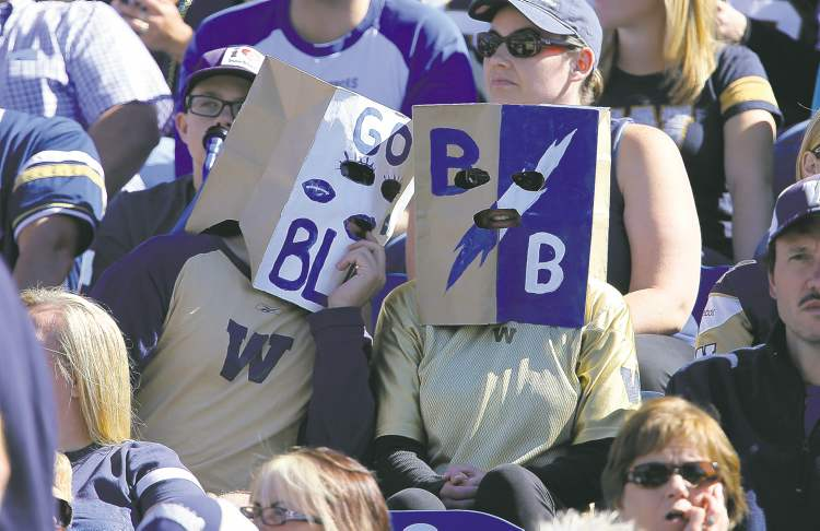 """The """"wear black to sack Joe Mack"""" movement never really got off the ground at the Banjo Bowl Sunday,  but some blue-garbed Bombers fans wore bags over their heads."""