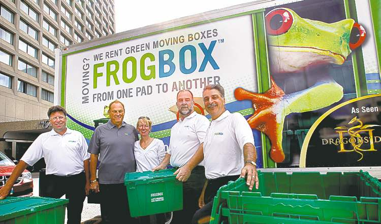 Jim Treliving (in dark shirt) meets with local Frogbox operators. Frogbox is one of the companies he has a stake in as a Dragon.