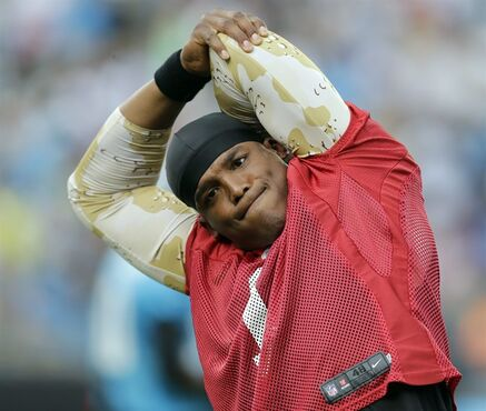 Carolina Panthers' Cam Newton stretches during an NFL football practice at the team's Fan Fest in Charlotte, N.C., Friday, July 25, 2014. (AP Photo)