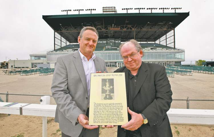 Assiniboine Downs CEO Darren Dunn (left) and track historian Bob Gates hold a plaque displaying the Manitoba Derby Trophy that disappeared years ago.