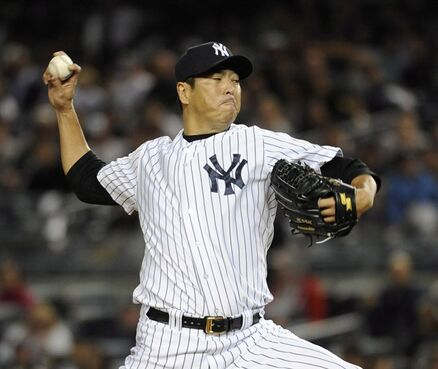 New York Yankees starting pitcher Hiroki Kuroda throws against the Toronto Blue Jays in the first inning of a baseball game at Yankee Stadium on Sept. 19, 2014, in New York. Japanese media report free-agent right-hander Hiroki Kuroda will return to Japan in 2015 to pitch for his first team, the Hiroshima Toyo Carp. THE CANADIAN PRESS/AP, Kathy Kmonicek