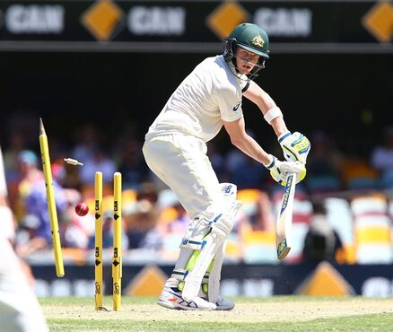 Australia's Steve Smith is bowled out by India's Ishant Sharma on the third day of the second cricket test in Brisbane, Australia, Friday, Dec. 19, 2014. (AP Photo/Tertius Pickard)