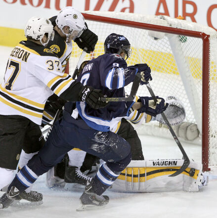 The Jets' Evander Kane in action near the Bruins' goal in action in Winnipeg on Friday.