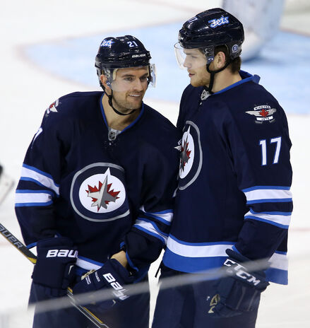 Winnipeg Jets' T.J. Galiardi (21), Michael Frolik (67), Grant Clitsome and Paul Postma celebrate a goal against the Carolina Hurricanes Tuesday night at the MTS Centre.