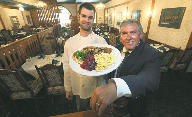 Gasthaus Gutenberger new owner-chef Jereme Labelle (left) and founder Kurt Wagner share a love of stick-to-your-ribs German fare.