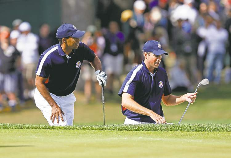 Jos�� M. Osorio / Chicago Tribune / MCT Tiger Wood and Matt Kuchar have a laugh on the first hole during a Ryder Cup practice round Thursday.