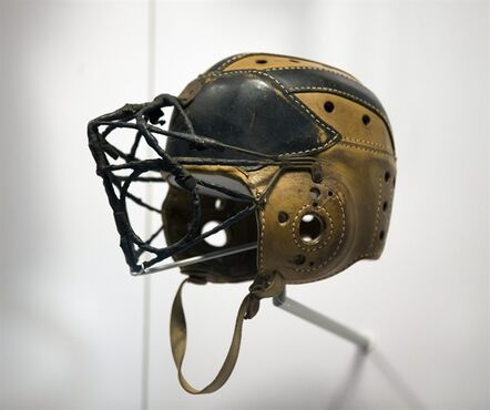 A vintage football helmet is shown at the College Football Hall of Fame, Friday, Aug. 22, 2014, in Atlanta. The College Football Hall of Fame finally is ready for its grand opening on Saturday following its move from South Bend, Ind. Fundraising issues forced several delays in the project, that had been scheduled to open in 2012. (AP Photo/John Bazemore)