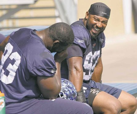 Bryant Turner (right) jokes around with fellow defensive lineman Kashawn Fraser during a break in practice at Investors Group Field Wednesday.