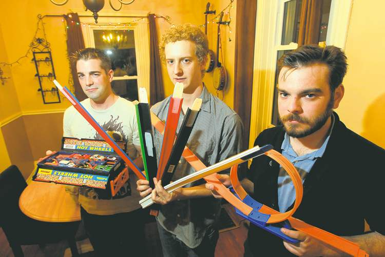 Making tracks: from left, Ryan Ash, Dan Huen and Craig Ward are hoping to collect enough Hot Wheels track to attempt to break a world record.