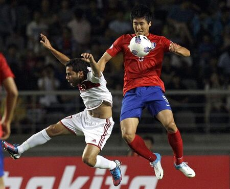 FILE - In this June 12, 2012 file photo, South Korea's Kwak Tae-hwi, right, fights for the ball against Lebanon's Hassan El Mohamad during their group A final round of Asia qualifying for the 2014 FIFA World Cup Brazil in Goyang, South Korea. The AFC Champions League final will give Al Hilal's Kwak an opportunity to win the title for a second time with a team from the opposite side of the continent. The 34-year-old South Korean international led Ulsan Hyundai to the 2012 title before moving to Saudi Arabia in 2013, initially with Al Shabab before joining Al Hilal in 2013. (AP Photo/Lee Jin-man, File)