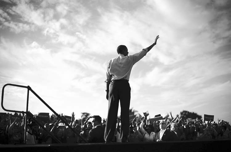 President Barack Obama waves to supporters after speaking to supporters during a campaign event at McArthur High School, Sunday, Nov. 4, 2012, in Hollywood, Fla.