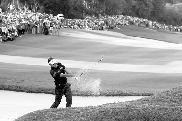 kin cheung / the associated pressIan Poulter hits from the bunker on the 18th hole during the HSBC Champions golf tournament Sunday.