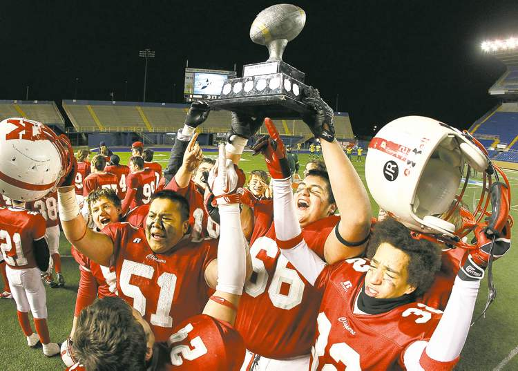 The Kelvin Clippers celebrate an emotional win over the Grant Park Pirates in the Winnipeg High School Football League's AA Free Press Bowl on Friday night.