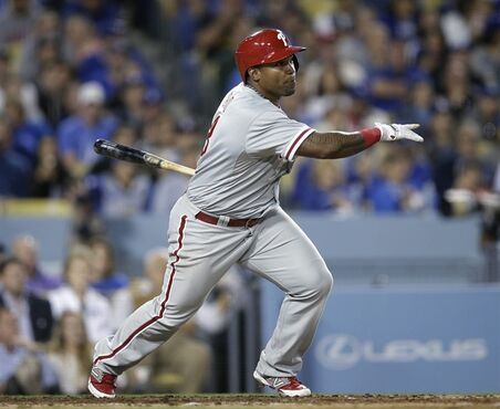 Philadelphia Phillies' Marlon Byrd watches his two-run double during the fifth inning of a baseball game against the Los Angeles Dodgers on Thursday, April 24, 2014, in Los Angeles. (AP Photo/Jae C. Hong)