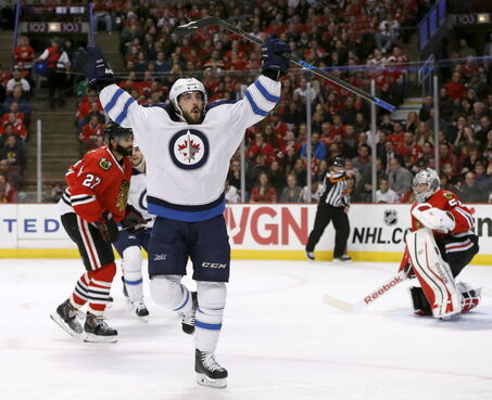 Winnipeg Jets center Mathieu Perreault celebrates after scoring on the Chicago Blackhawks on Tuesday in Chicago. The Jets won, 5-1.