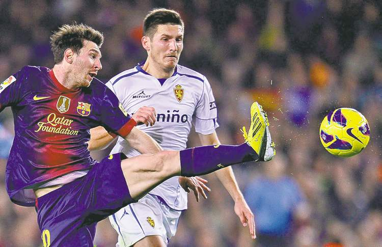 manu fernandez / the associated press archivesFC Barcelona�s mighty Messi (left) fires a shot against Zaragoza in La Liga action on Saturday.