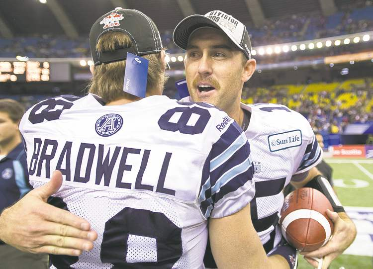 Paul Chiasson / the canadian pressArgos pivot Ricky Ray celebrates with teammate Mike Bradwell after defeating the Montreal Alouettes in the Eastern Final.