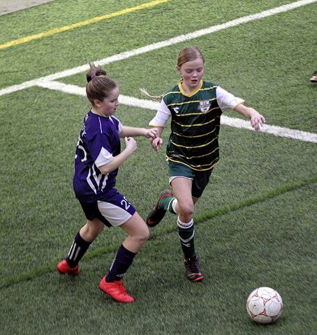 U10 Girls Ð Bonivital SC player Krisanna Fedoruk defends against an attacking FC Northwest player Logan Waller who scored both FCNW goals in a 2-0 victory.