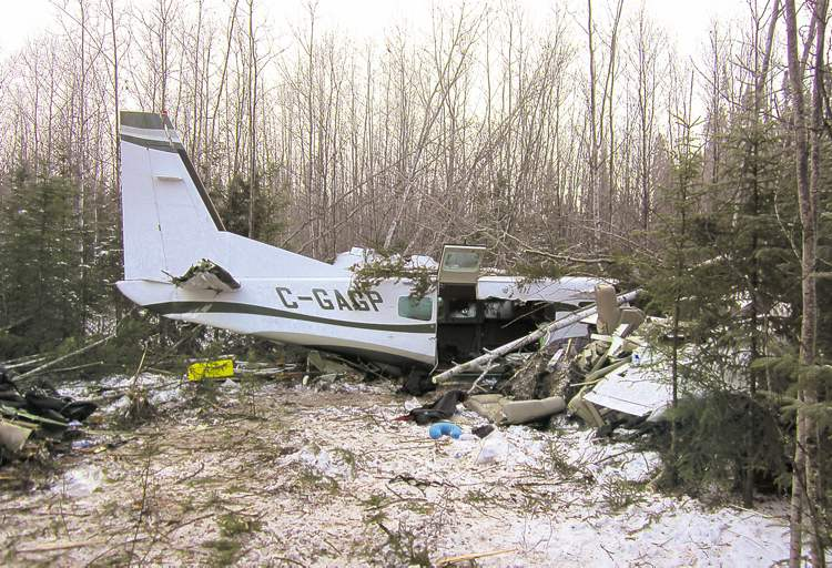 WInnipeg Free Press archives The wreckage of the Cessna 208 Caravan, which crashed into the bush about a kilometre from the Snow Lake airport Sunday. Pilot Mark Gogal was killed.