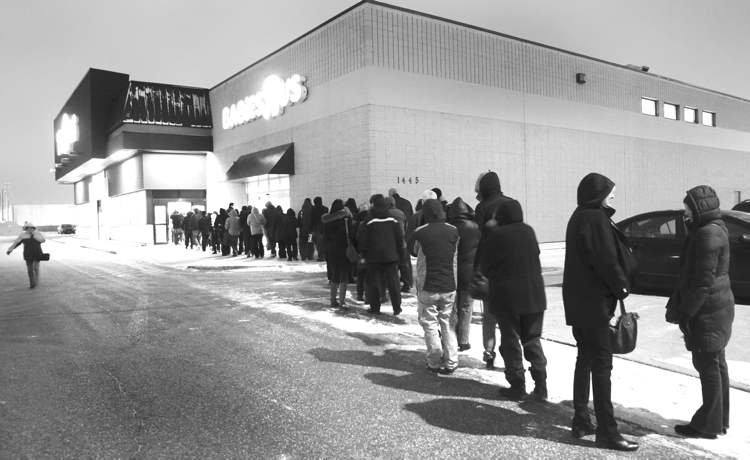 Photos by WAYNE GLOWACKI / WINNIPEG FREE PRESS Shoppers wait in line at the Polo-Park area Toys R Us at 7 a.m. Friday.