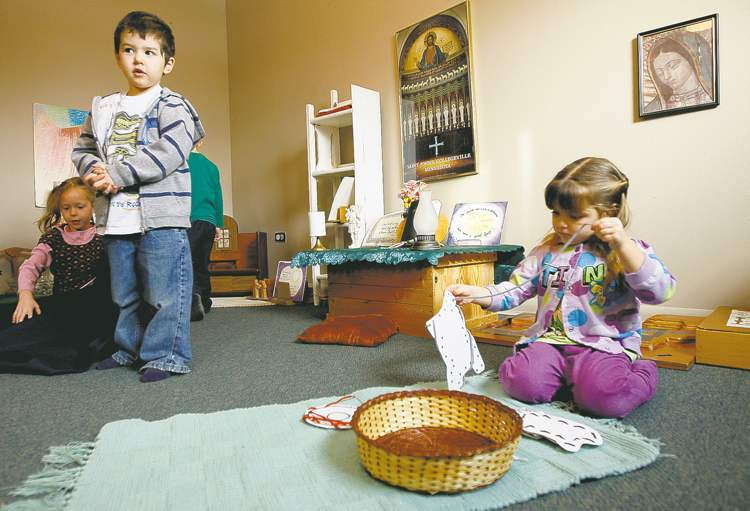 This classroom of preschoolers lives out the Christian calendar  --  and the Roman Catholic liturgy  --  by working with child-sized altars, crosses, vestments and other sacramental objects as part of the Catechesis of the Good Shepherd, a Montessori-style Christian formation program for children.