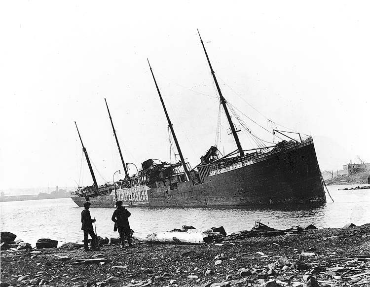 The Norwegian Imo is beached on the Dartmouth shore after the explosion.