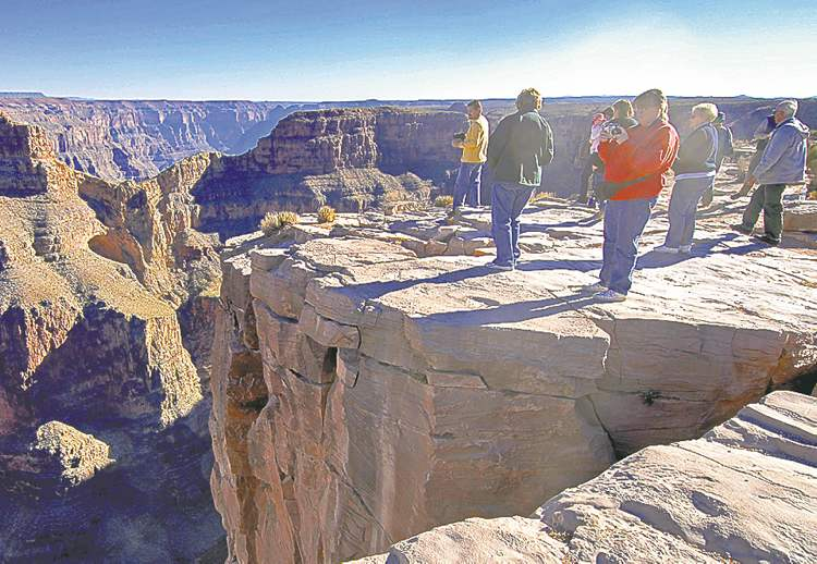 Jake Bacon / The Associated Press archivesTourists visit the western end of the Grand Canyon.