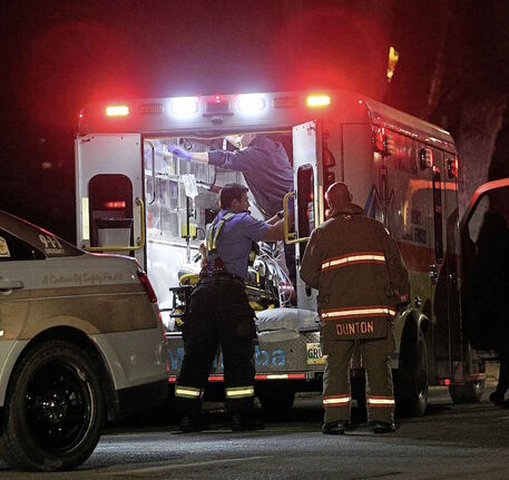 RUTH BONNEVILLE / WINNIPEG FREE PRESS FILES    Ambulance load patient into truck on Ellen street Wednesday evening.    Photo of ambulance for story on province ending ambulance funding deal.      Nov 29, 2017