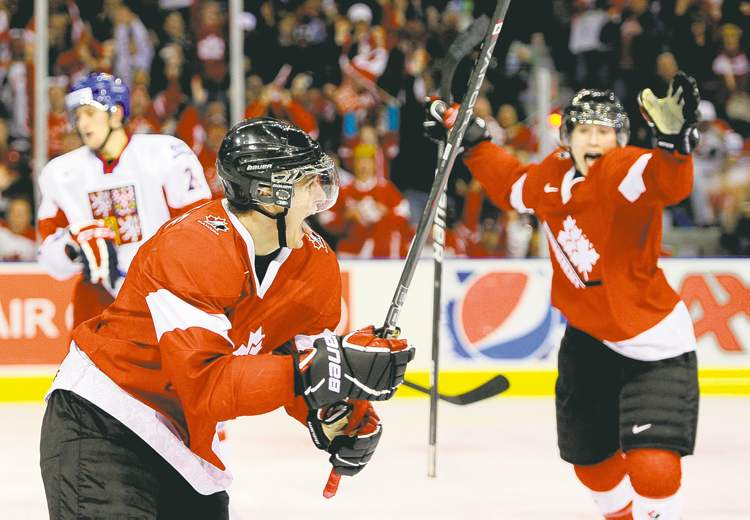 Winnipeg Jets' first-round draft pick Mark Scheifele (left) loves wearing the Team Canada uniform. With a good camp, he should be donning it again.