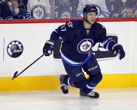 The Jets' Michael Frolik gets in on the second-period action Thursday.