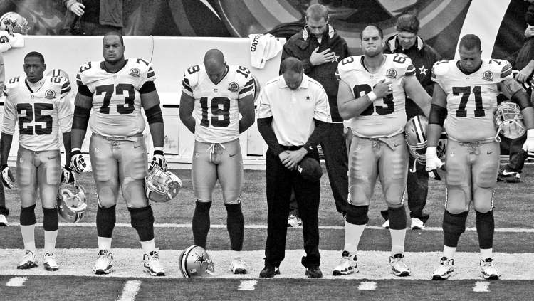 Members of the Dallas Cowboys hang their heads prior to Sunday's game against the Cincinnati Bengals during a moment of silence for teammate Jerry Brown. The league will be talking player safety this week.