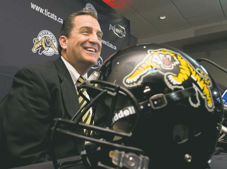 Frank Gunn / the canadian pressNewly named Hamilton Tiger-Cats coach, general manager and vice-president of football operations Kent Austin meets the media in Hamilton on Monday.