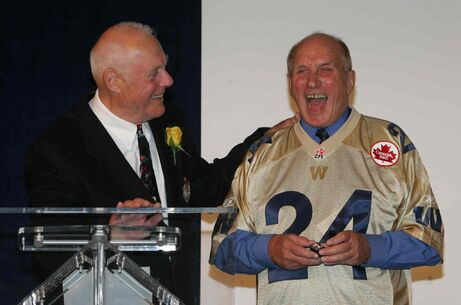 Bud Grant, left, presents Nick Miller with a championship ring in 2007.